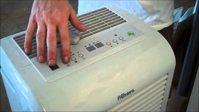 Turn on a dehumidifier in the room